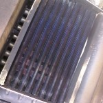Clean heat exchanger back on heater with blue flame