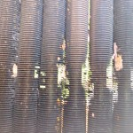 dirty heat exchanger removed from hayward 350 ready to be cleaned